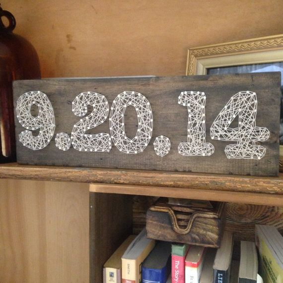 These custom Date boards are hand strung with string on weathered rough cut wooden boards. Due to the nature of the wood, each piece is unique
