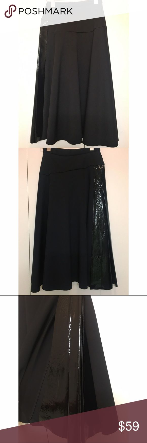 Topshop Unique black midi asymmetrical skirt Topshop Unique black midi asymmetrical skirt, size UK 6 (US2). Patent leather panel at side. In excellent condition. Made in UK. Topshop Skirts Midi