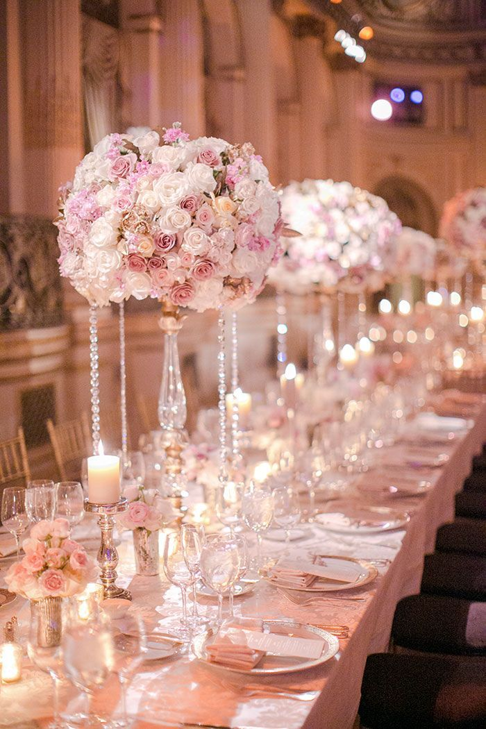 Beautiful blush, tall centerpieces  To book your FREE consultation on your own dream wedding, contact us at admin@vibaciousevents.com