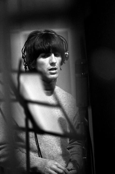 """The Beatles - George Harrison during a recording session for the album """"Revolver"""""""