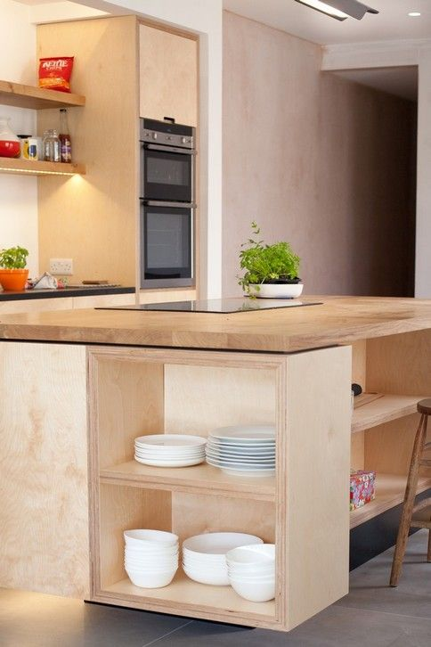 Industrial 'floating' island & kitchen made of 50mm thick plywood and push to open drawers with a solid Oak top and breakfast bar and Neff Appliances