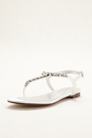 Pearl and crystal embellishment makes this t-strap sandal an elegant and  comfortable option for