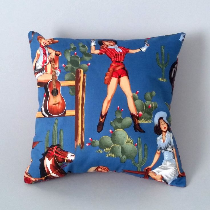Our 'Holy Cowgirl' cushion combines Alexander Henry cowgirl fabric in midnight blue with Gosh's favourite Holy Cow! fabric in red by Windham.