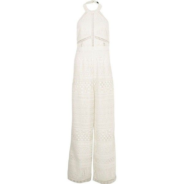 River Island Cream lace halter neck wide leg jumpsuit ($240) ❤ liked on Polyvore featuring jumpsuits, sleeveless jumpsuits, lace halter top, cream jumpsuit, white wide leg jumpsuit and white lace jumpsuit