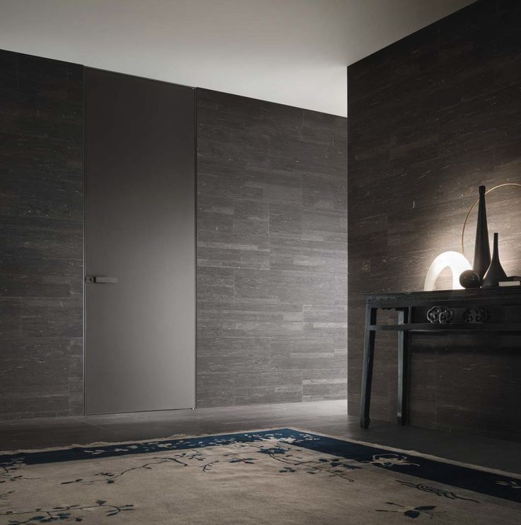 Moon door with brushed bronzo structure and mat lacquered moro glass.