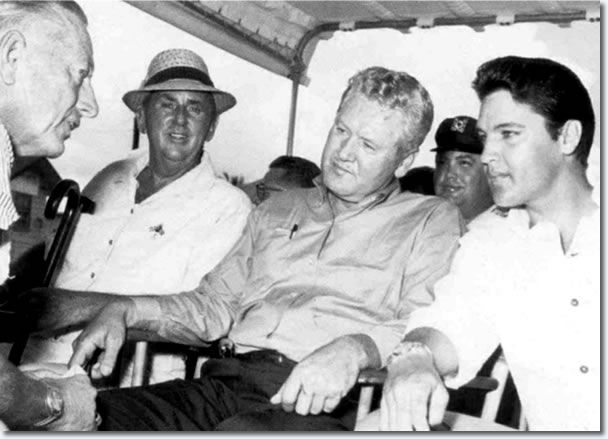 In 1965, Colonel Parker, Vernon and Elvis visit the USS Arizona Memorial for the first time.