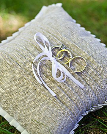The mother of the bride sewed the pleated ring pillow for this real wedding
