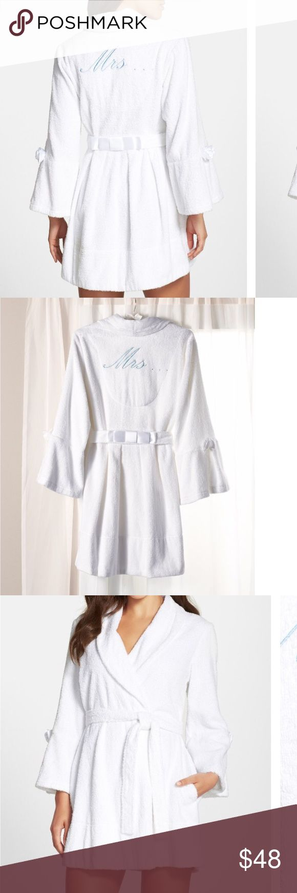"""🎉SALE🎉 Betsey Johnson Blue Mrs. Embroidered robe Embroidered hearts surround the words, 'I do' inside a plush terry robe accented with ribbon bows on the belled sleeves and on the back sash tie. An embroidered 'Mrs.' finishes the back of the honeymoon-ready style. 33"""" length (size Medium). Front tie closure; interior anchor tie. On-seam pockets. Attached belt. 100% cotton; machine wash cold, tumble dry low. Betsey Johnson Intimates & Sleepwear Robes"""