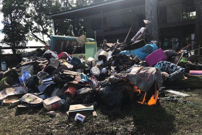 Mud covered belongings in Luscombe home