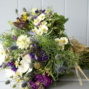 seasonal flower and herb bouquet - berries, too? Tied up with lots of trailing ribbons