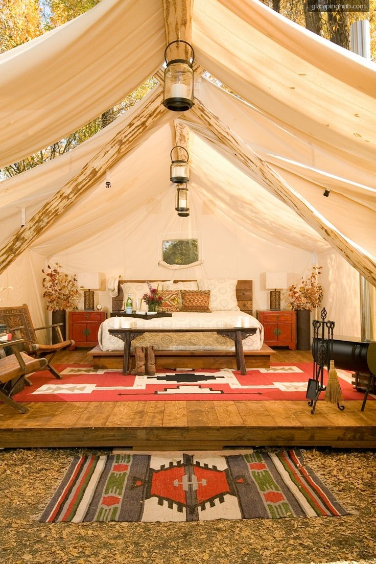 I love the white washed beams and the bold print rugs! Click image to see full glamping site profile. #glampingstyle
