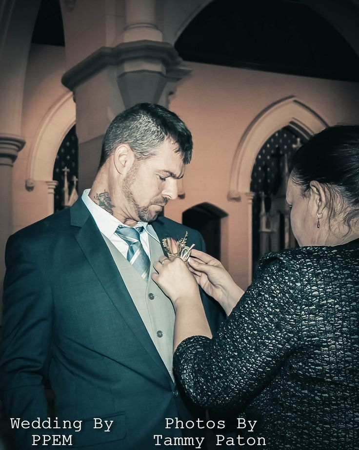 Not only does a planner make sure our bride is happy throughout the day we also secure those last minute details a groom needs. Such as attaching the buttonhole.