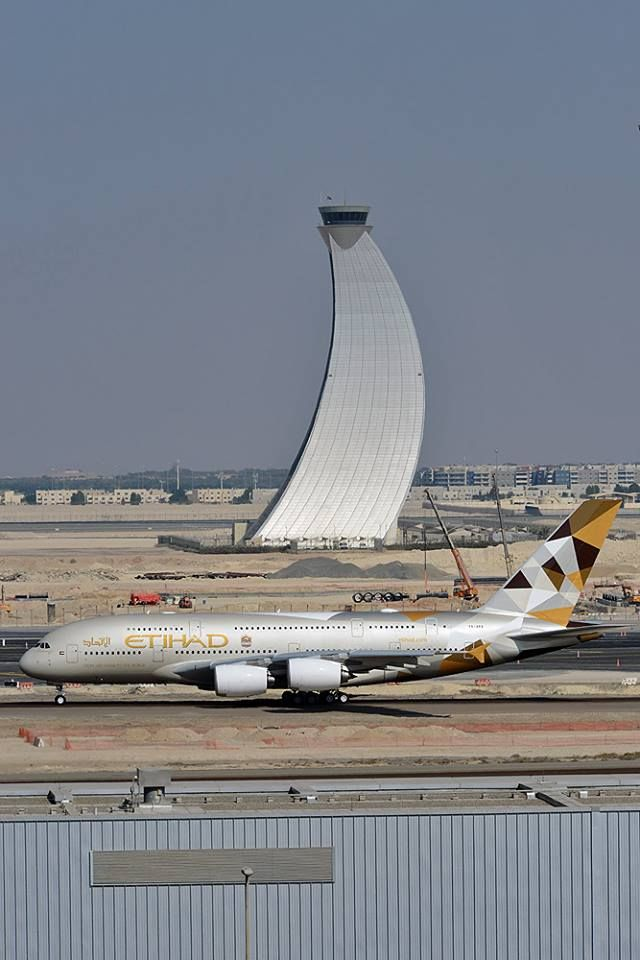 Etihad Airways Airbus A380-861 A6-APA passing in front of one of the world's most iconic Air Traffic Control Towers at Abu Dhabi International Airport, December 2014. (Photo: Sam Chui)