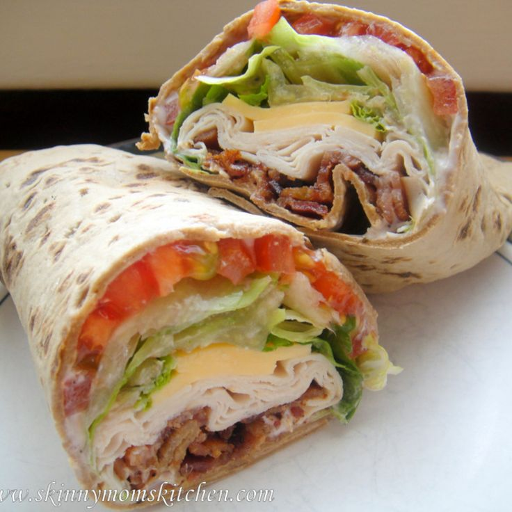 TURKEY RANCH CLUB WRAP 1 Wrap 2 ounce of smoked turkey 1/2 slice sharp american cheese Bacon 1 tablespoon Ranch yogurt dressing  2 tomato slices Romaine lettuce