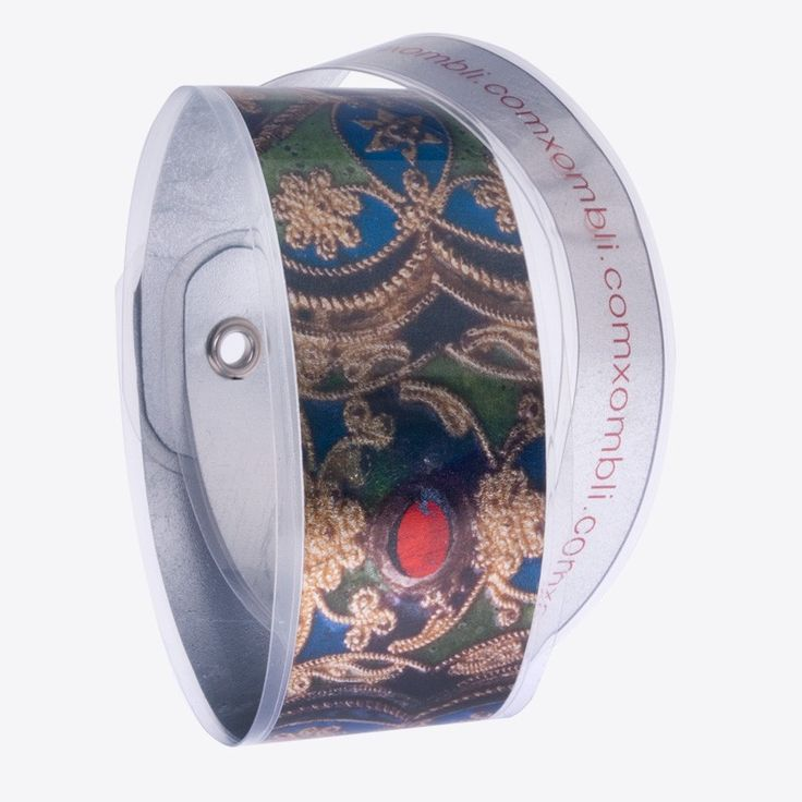 Digitally printed bracelet with motifs of traditional Greek embroidery. Made of silver leaf and plastic film. Stamatis Zannos designs jewels inspired by the contemporary Greek civilization as it is showcased in museums. Zannos has presented his work in several venues, including the Benaki Museum in Athens.