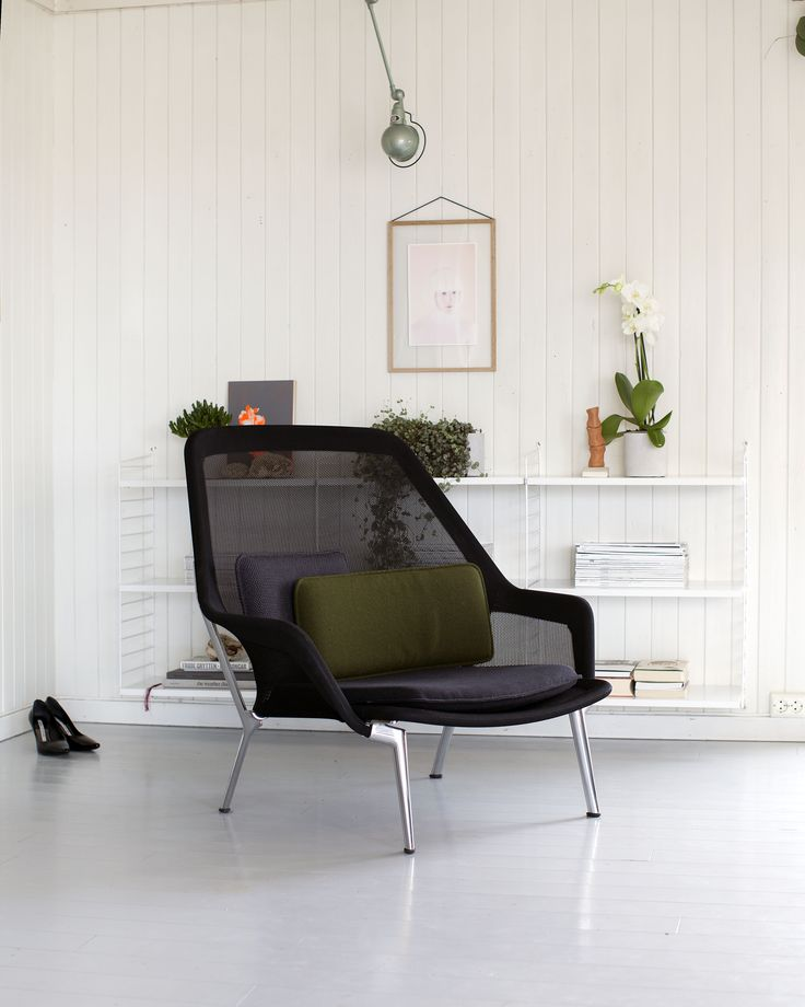 Slow chair by Vitra, String shelves, jielde lamp and art work by Image Troopers. Janne Svit.