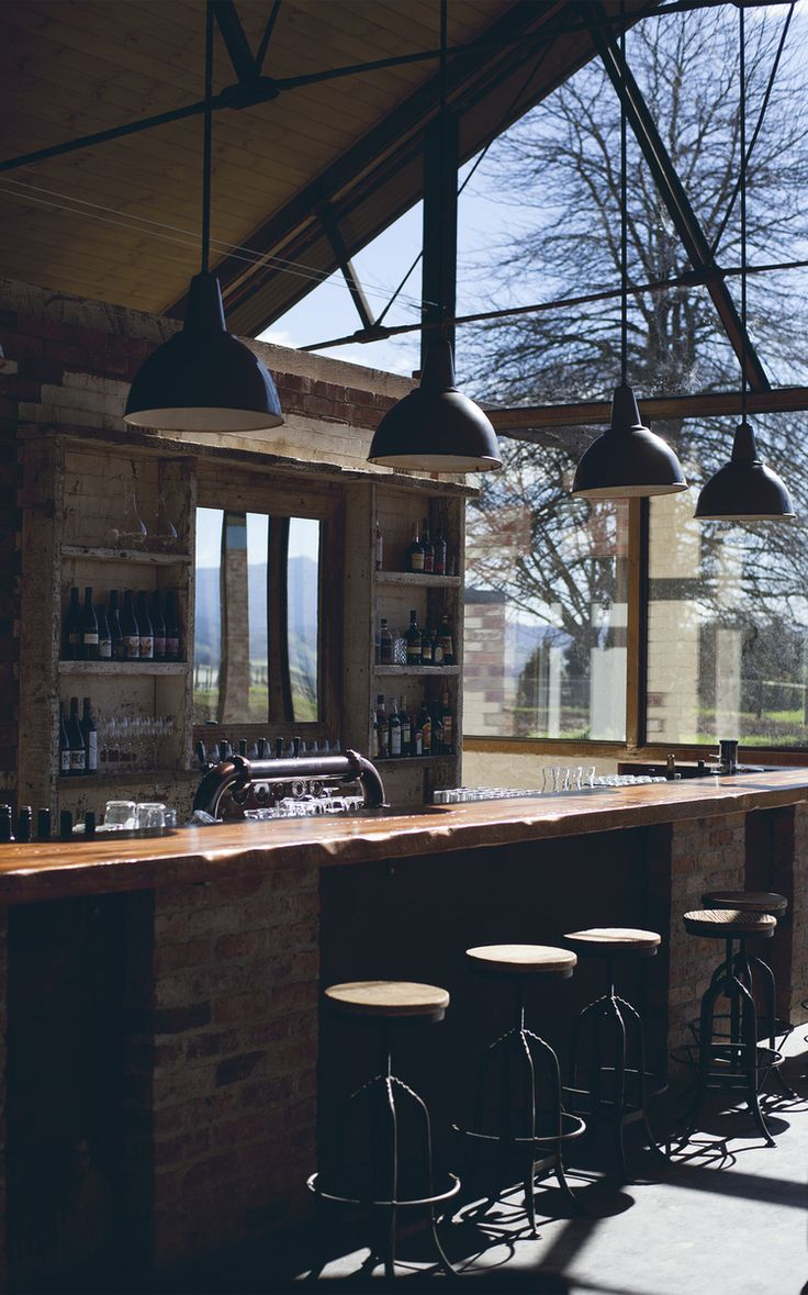 Not a bad spot to sit at the bar and enjoy a nice glass of wine.. #bar #wine #rustic #lights #brick #barstools #windows #views #country #yarravalley #meletos