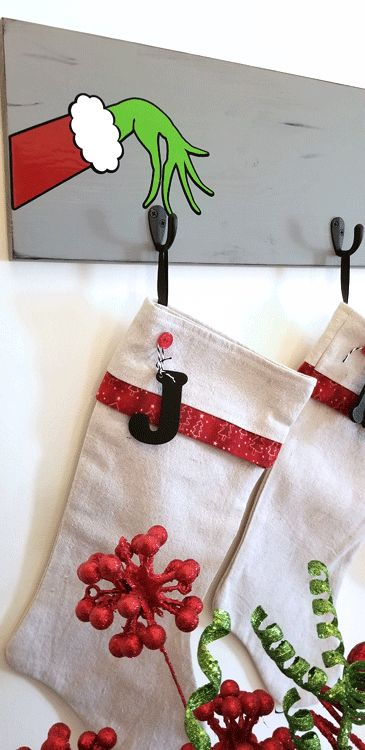 diy grinch inspired stocking wall hanger christmas on wall hanger id=35081
