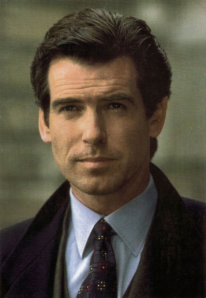 https://flic.kr/p/KrzhZG | Pierce Brosnan in Goldeneye (1995) | American postcard by Classico, San Francisco, no. 105-454. Photo: Danjaq / United Artists Corporation / Eon Productions / Mac B. Photo: publicity still for Goldeneye (Martin Campbell, 1995).  Irish film and television actor and film producer Pierce Brosnan (1953) is best known for his recurring role as British spy 007 in the popular James Bond film series. He first won over television audiences in the detective series Remington…