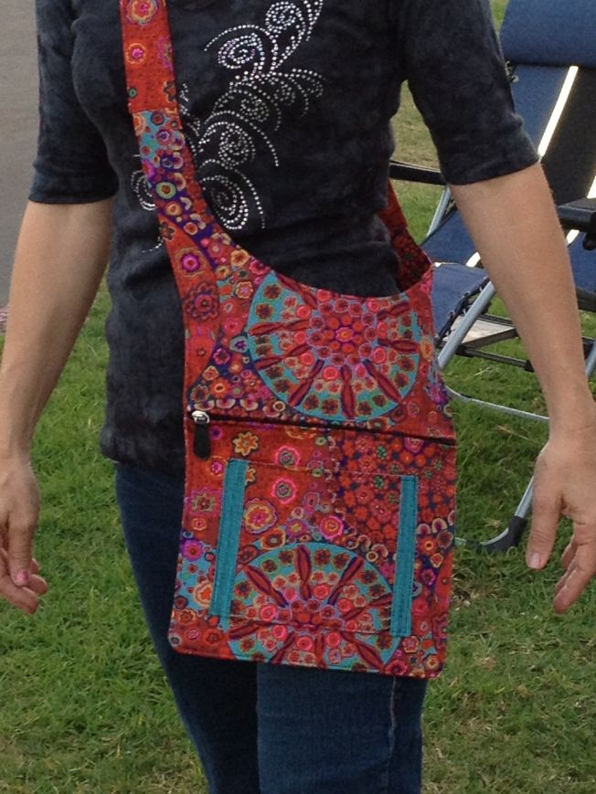 Over shoulder purse.  Fabric pattern is definitely flexible.  I want this type of style.