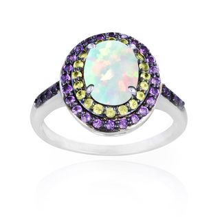 This spectacular ring showcases an oval opal surrounded by shimmering amethyst and peridot gemstones. This finely-crafted sterling silver ring features a high polish finish, giving it the perfect shin