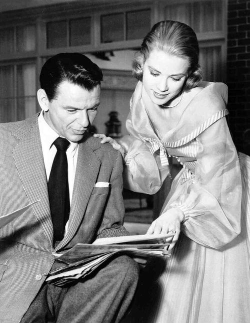 Frank Sinatra and Grace Kelly photographed on the set of High Society.