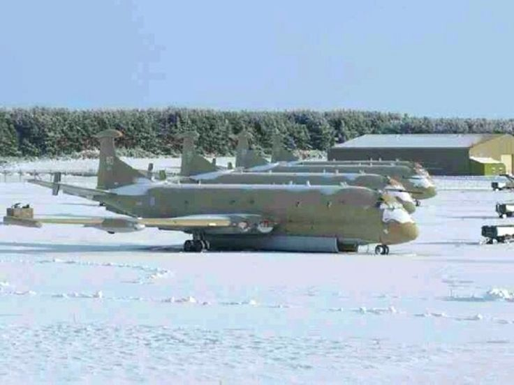 Nimrods in the snow, RAF Kinloss on aircraft sevicing bays 15,16 & 17.