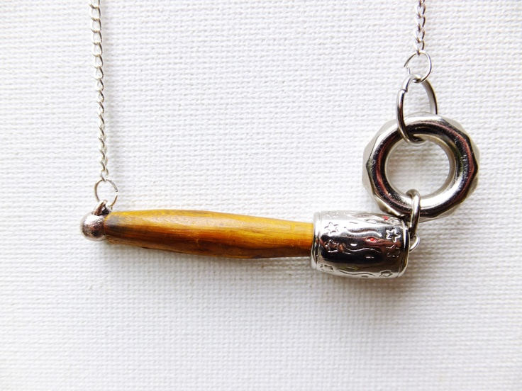 Asymmetrical wooden and silver hoop necklace. Available through my website www.eklecticmix.com.au