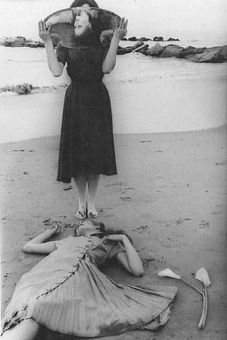 Francesca Woodman.  I can explain this picture in many levels, but it would never be enough. No murder can feel the pain of the victim, so stop trying.