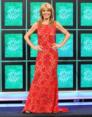 JOVANI: Red lace over nude lining gown enhanced w/silver & aurora rhinestones, scoop neckline, sleeveless, low v-back, flared hemline w/train | Wheel of Fortune | Vanna White's dresses