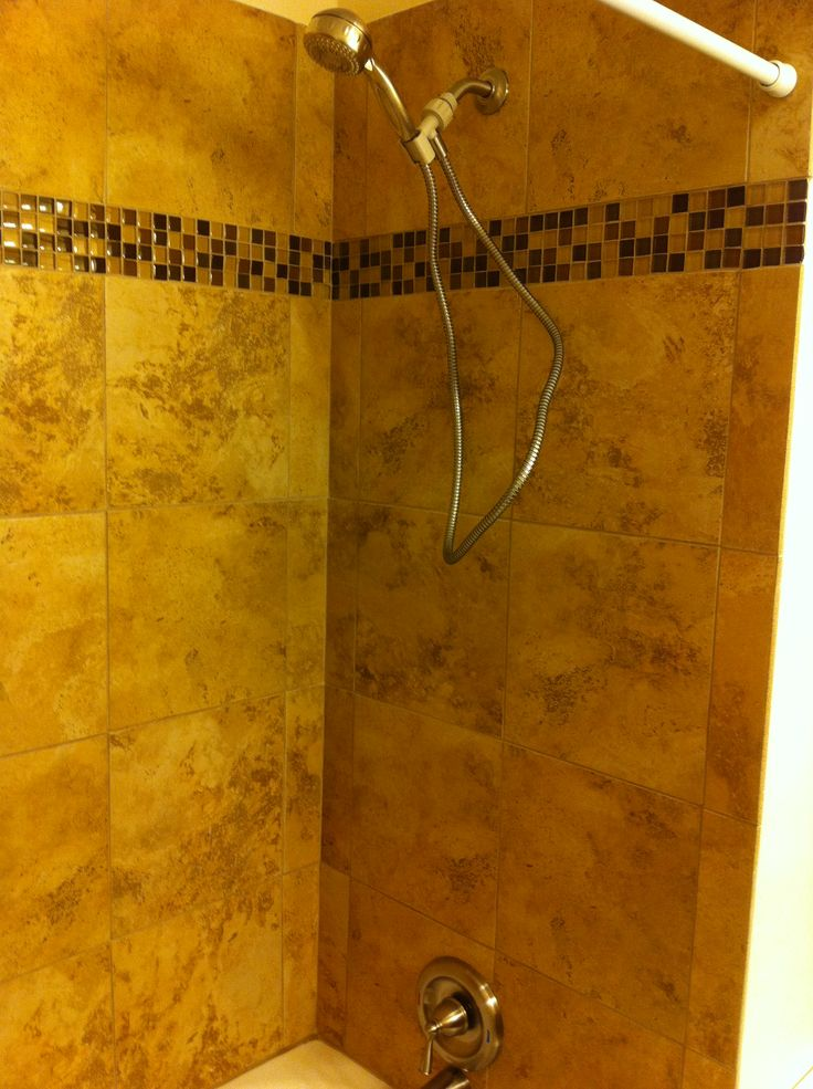 Glass Tile In The Bathtub Surround Adds A Subtle Elegance