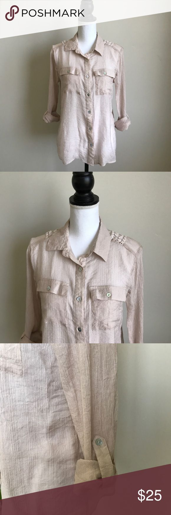Quiksilver women's beige blouse crochet size M Beautiful button down blouse from Quiksilver. Beige with crochet detail on the back and roll up sleeves. Size medium. Quiksilver Tops Button Down Shirts