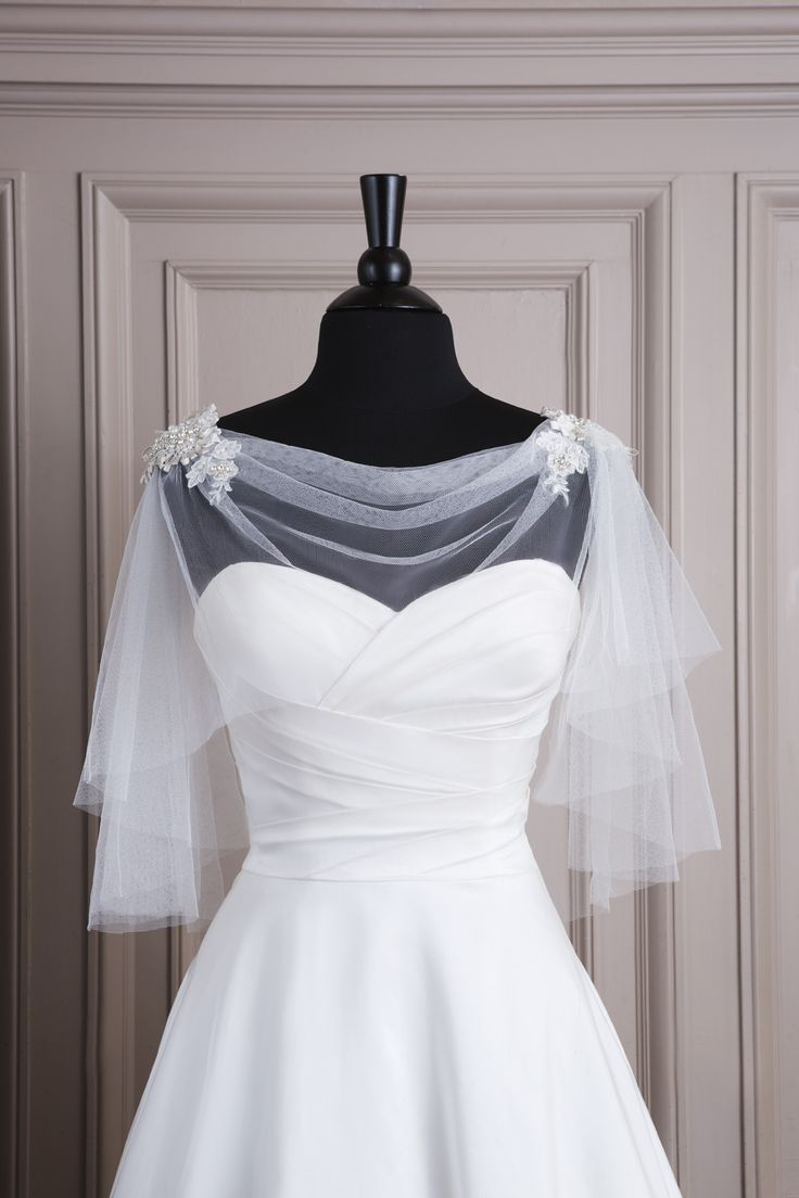Justin Alexander wedding accessories style A062 Tulle caplet with cowl neckline and lace appliques at the shoulders.