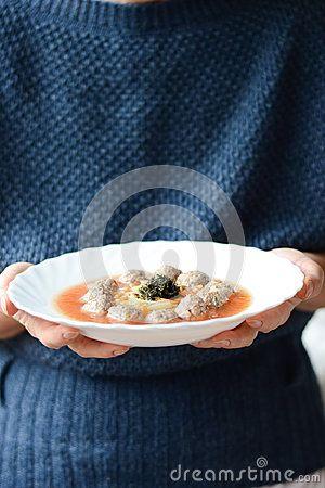 Woman holding soup