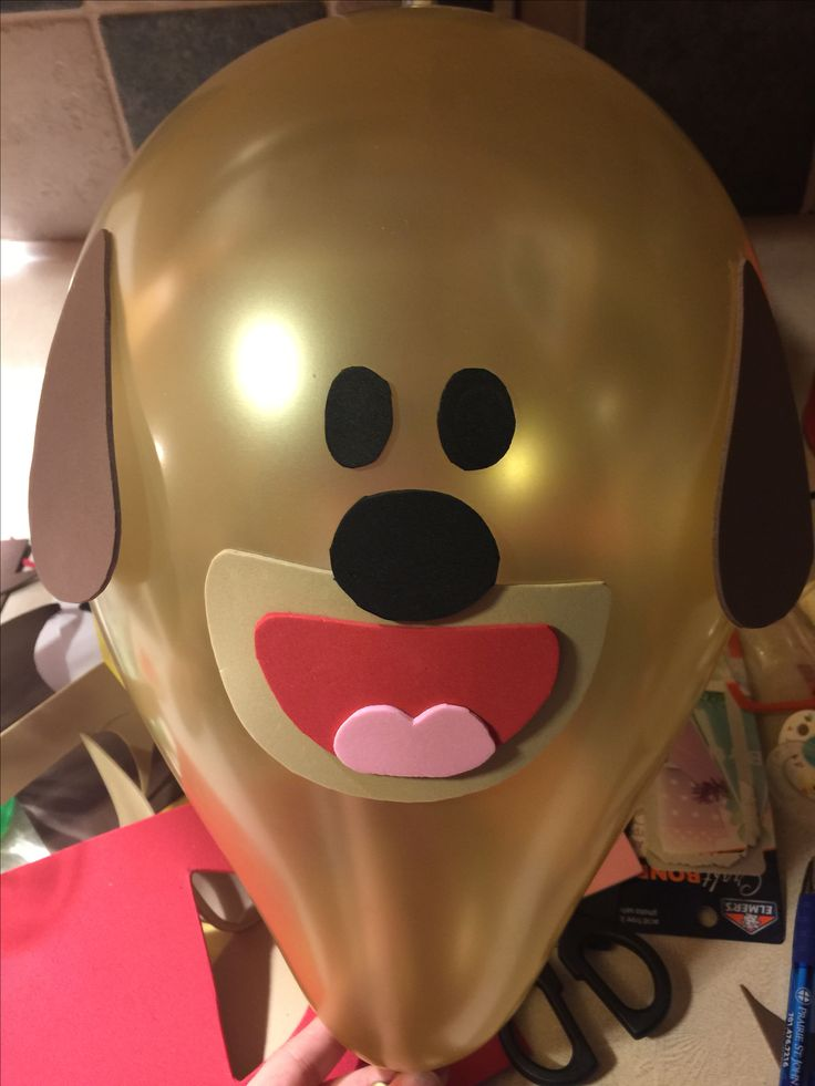 Hey Duggee balloons I made for my 2 yr old's birthday party! Gold balloons were the closest color to brown I could find at Walmart. Then I used foam paper for the ears, eyes, etc. and glued them on using an Elmer's crafting glue stick, I'm sure double stick tape would work as well.