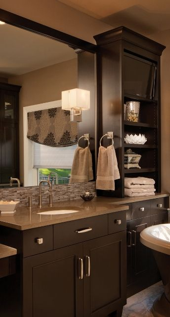 The closed #storage areas can include a #vanity, ideally with as many drawers as possible, and/or a linen #cabinet of some type.  It's what goes inside that can make a big difference in the functionality of the #space. - Dura Supreme #Bathroom #Cabinetry