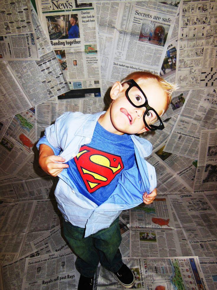 DIY newspaper backdrop and Superman photo idea