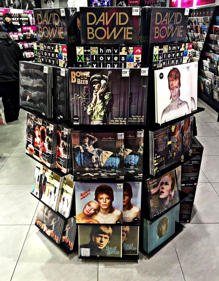 This would be my kinda place... nothin' but Bowie albums and memorabilia, all sorts of Bowie merchandise...you know? Gosh. someone should make a literal store like that... A real life, in-person, tangible store with an open and closed sign and everything! ...Ooooh!