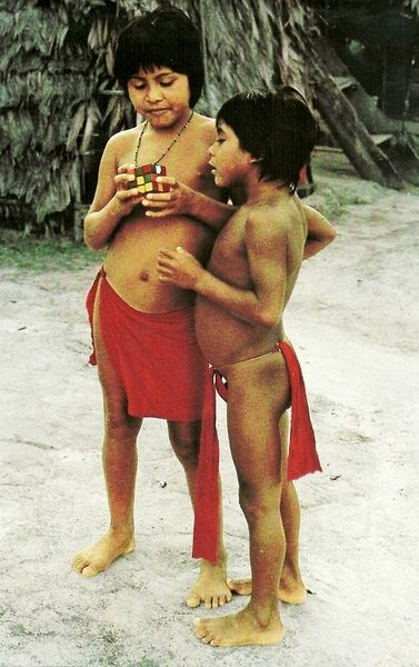 South America's Wayana-Aparai Indian youth figure out a rubiks cube. The Wayana-Aparai Indians are indigenous people of the northern area of South America, principally Brazil, Surinam and French Guiana.  (National Geographic, January1983)