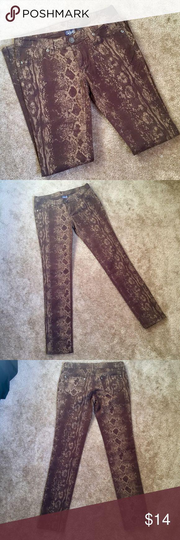 "Brown Snakeskin Print Skinny Jeans Like new skinny jeans in a fun snakeskin/reptile print.   Measurements:  • Inseam: 30""  • Waist 30""  Material: 99% cotton, 1% spandex City Streets Jeans Skinny"
