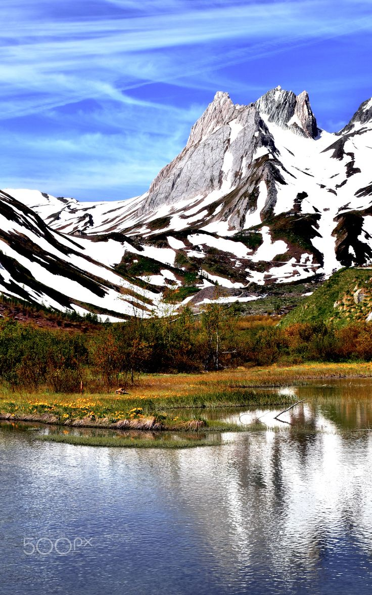 la piramides calcares - the piramides calcares reflected in the waters of Lac Combal