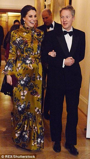 The Duchess of Cambridge shared a light-hearted moment with ambassador David Cairns on her way into the formal dinner