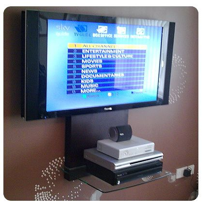 Wall mounted TV with holder for boxes