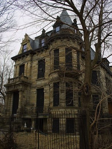 Haunted Franklin Castle (OH):  A gloomy exterior, secret passageways, children crying, voices arguing in the walls, chandeliers spinning, faces materializing in the woodwork, a reoccurring blood stain, and a mysterious woman in black who appears in the top-most turret window. Other peculiarities about the home are almost as creepy: a room that is noticeably colder than the rest of the house, baby skeletons said to have been discovered in the 1970s, and the macabre history of its original…