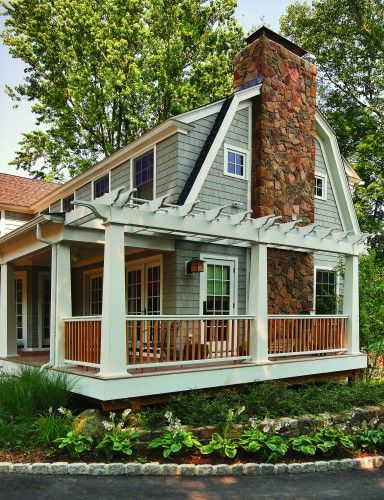 Covered porch and trellis style extension help a small house live large in warm months.