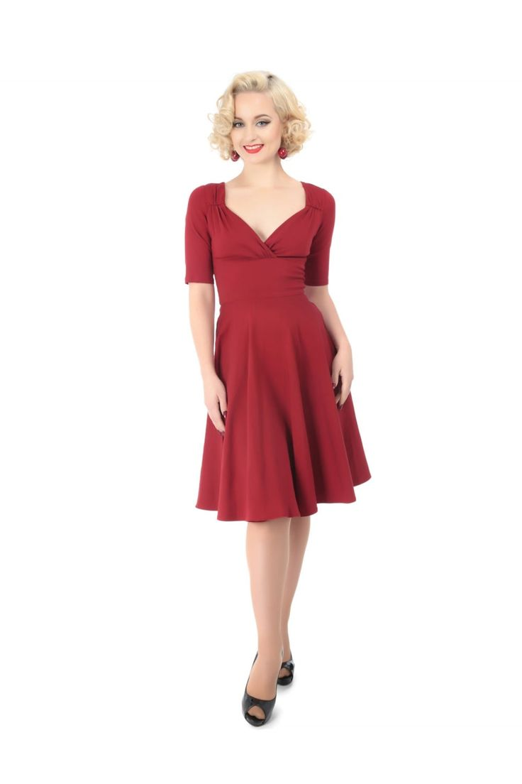 The Trudie Doll Dress is made in figure flattering stretch bengaline that ensures a smooth silhouette, the Trudie Doll is a versatile frock perfect to bring you from daytime wear right into the evening. Featuring a fold over detail to the bust line as well as gathering detail that's reminiscent of the 1940s, and with a full swing skirt. Trudie is ideal for dressing up or down with either flats or heels.
