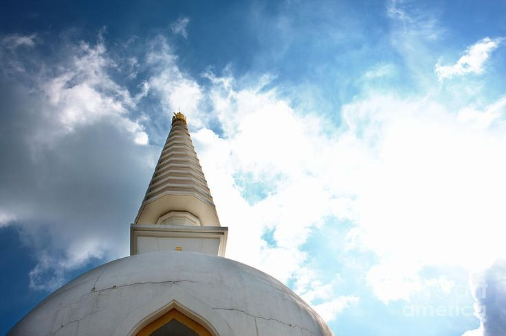 Stupa And Bright Sky Photograph. Stupa reaching for the sky.  Free from Wikipedia: A stupa is a mound-like or semi-hemispherical structure containing Buddhist relics, typically the ashes of Buddhist monks, used by Buddhists as a place of meditation.