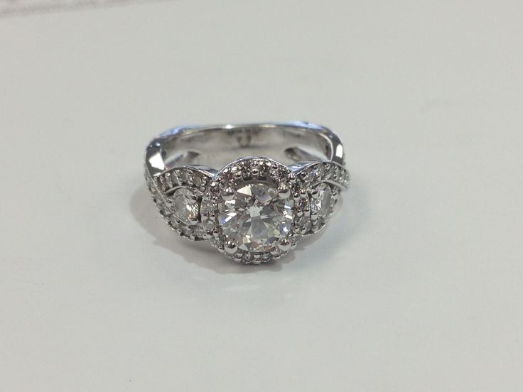 Halo engagement ring. www.abrahamsjewellery.com