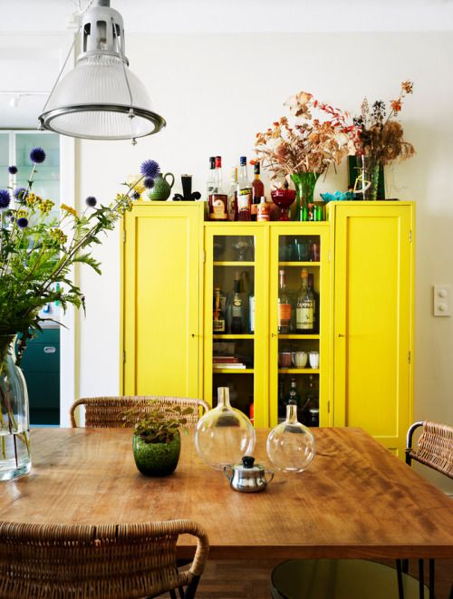 Bright yellow large storage armoire. vintage/antique.