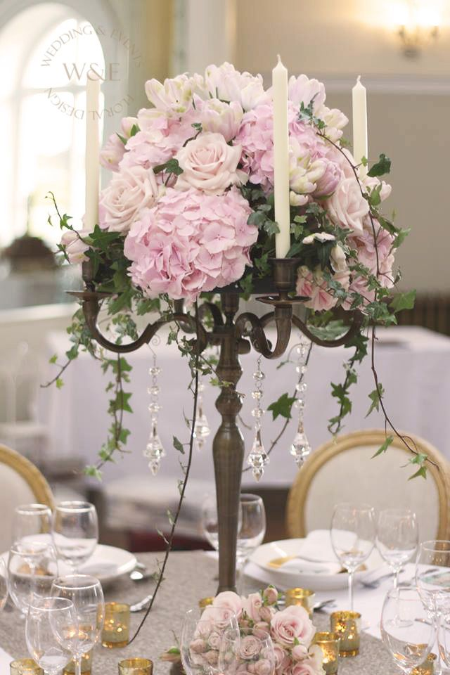 Elegant pink candelabra design with hydrangea roses and